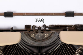 Close up of a typewriter and page with the acronym FAQ typed on it